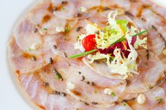 Close up of cod carpaccio. Royalty Free Stock Images
