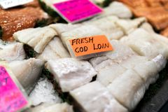 Close up of cod loin fillets with an encapsulated luminous orang Royalty Free Stock Photos