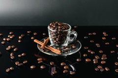 Close up coffee bean in cup glass dark background Stock Image