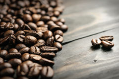 Close up coffee bean on wood background Royalty Free Stock Image