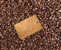 Close-up of coffee beans background and blank tag Stock Photo