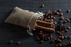 Close up of coffee beans and cinnamon sticks. And anise Stock Photos