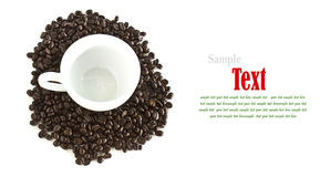 Close up of coffee beans and coffee cup on white background Royalty Free Stock Photo