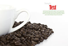 Close up of coffee beans and coffee cup Royalty Free Stock Image