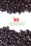 Close up of coffee beans and coffee cup Stock Photography