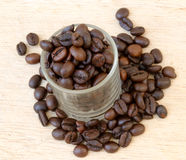 Close up of coffee beans and a cup full of coffee Royalty Free Stock Photo