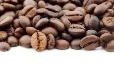 Close up of coffee beans isolated on white background. Close up of coffee beans isolated on a white background Stock Image