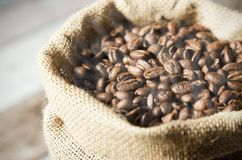 Close up coffee beans in jute bag Royalty Free Stock Image