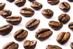Coffee beans pattern isolated on white background. Close up coffee beans pattern isolated on white background Royalty Free Stock Images