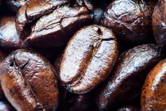 Close-up of coffee beans scattered. Background Royalty Free Stock Photo