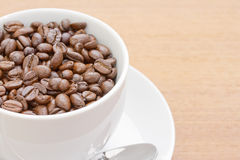 Close up coffee beans in white cup Royalty Free Stock Image