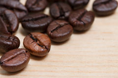 Close-up coffee beans on wood table Stock Photography