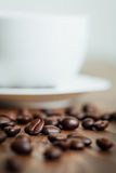 Close up coffee beans on wood. Table Royalty Free Stock Image