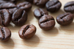 Close-up coffee beans on wood table Royalty Free Stock Photo