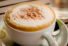 Close-up of Coffee. Cappuccino coffee cup,backlight Royalty Free Stock Image