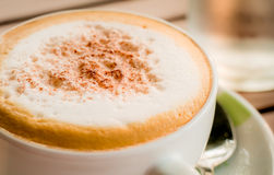 Close-up of Coffee. Cappuccino coffee cup,backlight Stock Photos