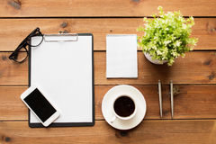 Close up of coffee, clipboard and notepad Royalty Free Stock Photo