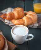 Close-up of coffee with continental breakfast on dark background stock images