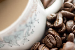 Close-up of coffee cup. Close-up of a coffe cup and beans stock images
