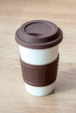 Close up coffee cup on blurry wood table background Royalty Free Stock Photo