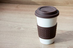 Close up coffee cup on blurry wood table background Royalty Free Stock Photos
