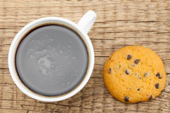 Close up of coffee cup and cookie on old wooden table Royalty Free Stock Image