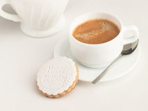 Close up of coffee cup and fondant covered cookie. Happy birthday decoration on top. Royalty Free Stock Images