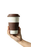Close up coffee cup in hand on isolate background Stock Image