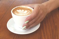 Close up of of coffee cup and hands. royalty free stock images