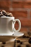 Close-up Coffee Cup With Beans Royalty Free Stock Image