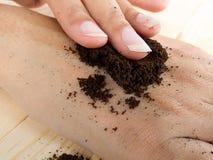 Close up coffee hand scrub with ground coffee Stock Photography