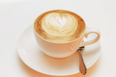 Close up of coffee latte cappuccino heart. On a white background stock photography