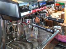 Close up coffee machine preparing fresh coffee. Stock Image