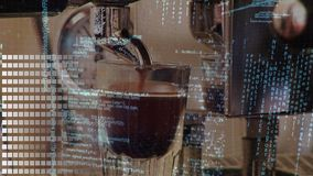 Coffee maker and interface codes. Close up of a coffee maker dispensing coffee while program codes are running in the background stock video