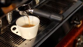 Close up coffee maker machine with white coffee cup. Coffee machine prepares. Coffee espresso preparation. stock video