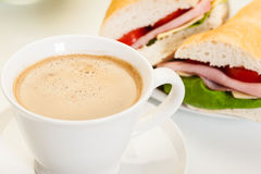 Close-up of coffee with panini sandwich Stock Photography