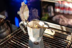 Close up coffee pot old aluminum open breakfast morning market on stove with sunlight royalty free stock photography