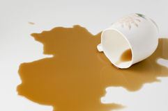 Close up coffee stains on white background. A coffee cup full of coffee collapsed Royalty Free Stock Image