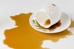 Close up coffee stains on white background. A coffee cup full of coffee collapsed Royalty Free Stock Photography