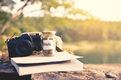 Close up coin on glass jar with travel word Royalty Free Stock Images
