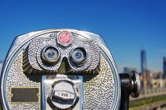 Close up of coin operated binoculars. With New York City skyline in background Royalty Free Stock Photo
