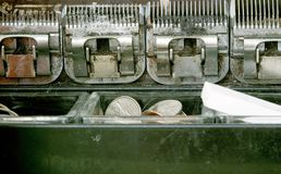 Close Up of Coin Operated Machine Mechanisms royalty free stock photos