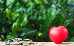 Close up of coins and red heart, Money, Financial Stock Photos