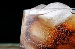Close up cola glass with drops and ice Royalty Free Stock Photography