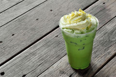 Close up cold green tea and cream Royalty Free Stock Images