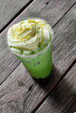 Close up cold green tea and cream Royalty Free Stock Photo