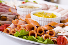 Close Up Of Cold Meat Catering Platter. With cold cuts of meat including sliced chicken breast, mortadella, salami, roast beef, ham, turkey, cabana sausage and stock photos