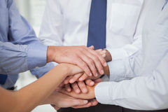 Close up on colleagues hands all together Stock Photography