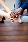 Close up of colleagues' hands clasped together Royalty Free Stock Photos