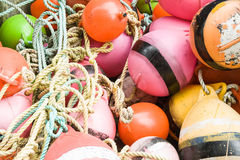 Close up of a collection of bright buoys. Stock Images